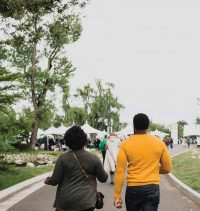 Two people walk down a road at the event